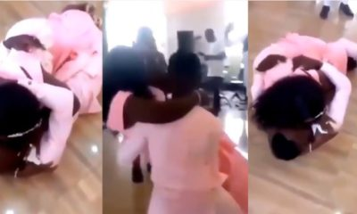 The groom crashed to the ground while attempting to carry his bride