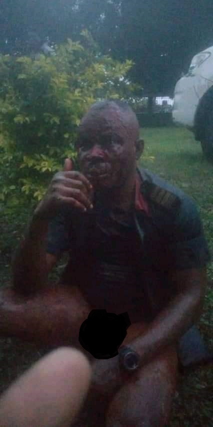 The Civil Defence officer after he was caught and beaten mercilessly