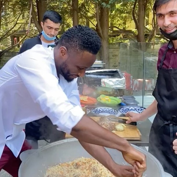 Mikel Obi cooking food for his twin daughters on their birthday