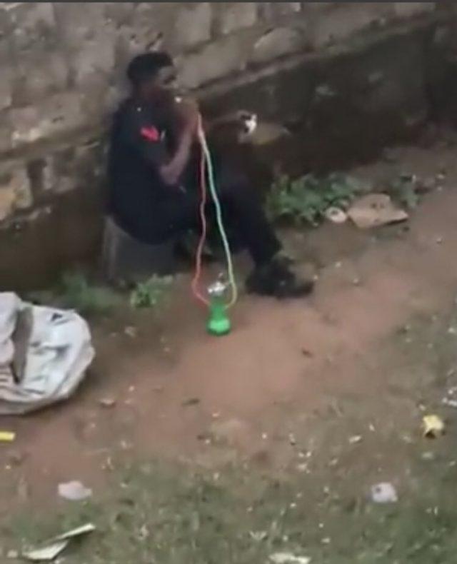 Policeman smoking shisha