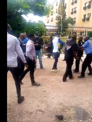 Police officers assault protesters in Abuja