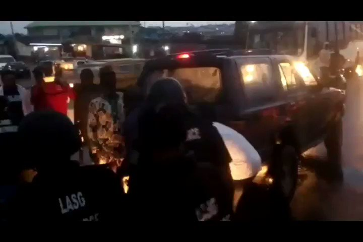 A naval officer and Lagos task force officials fight