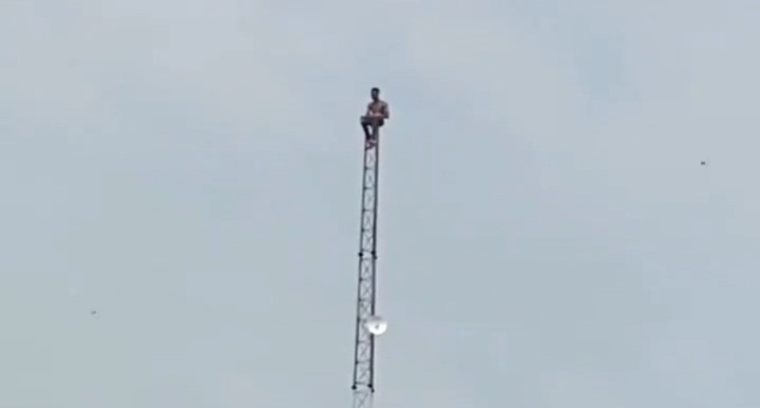 Depressed man on top a mast