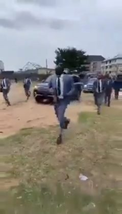 Pastor storms church with armed security and long convoy
