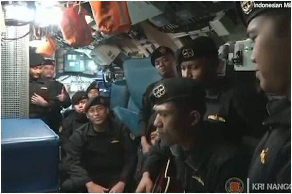 Indonesia submarine crew members singing before their submarine sank