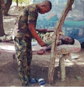 Touching photo of the Nigerian soldier receiving treatment