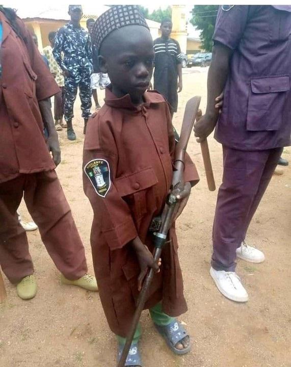10-year-old vigilante member carrying gun