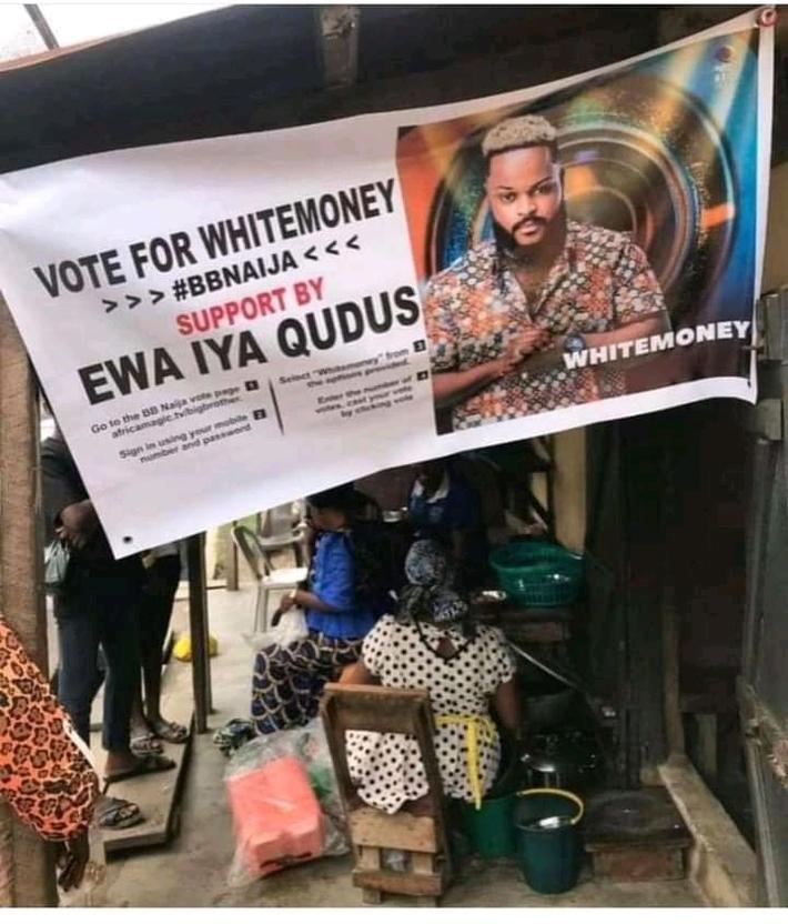 Vendor mounts banner for Whitemoney