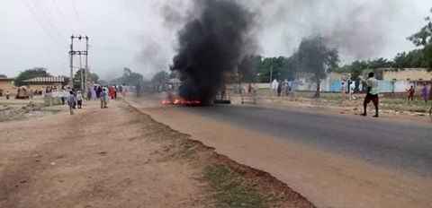 Youths block highway