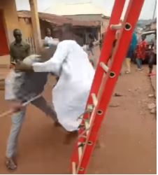 Soldier's sons beating the KEDC official