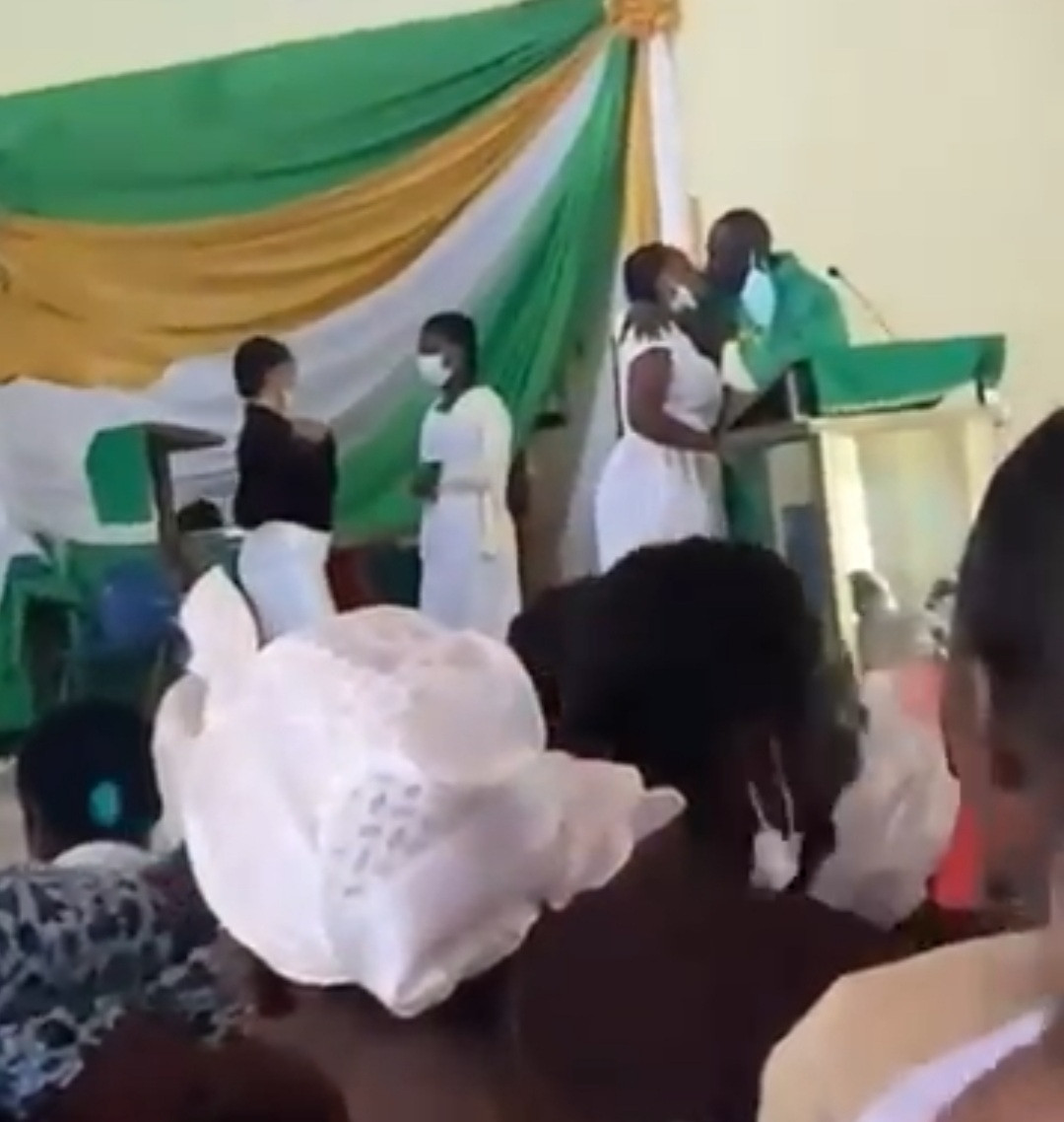 The priest kissing female students
