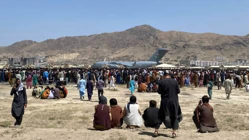 Afghans gather near Kabul airport