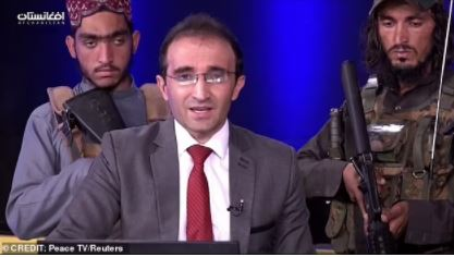 Presenter surrounded by Taliban militants
