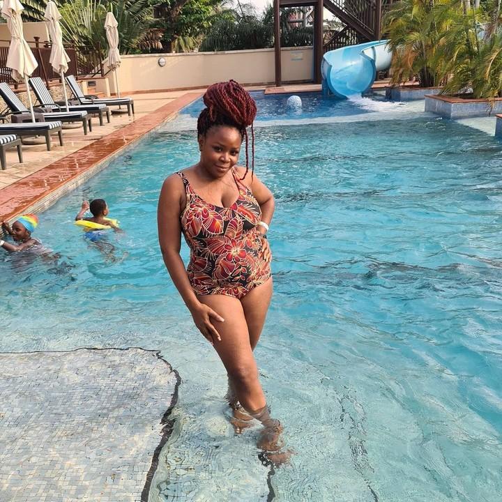 Omawumi posing in a swimsuit