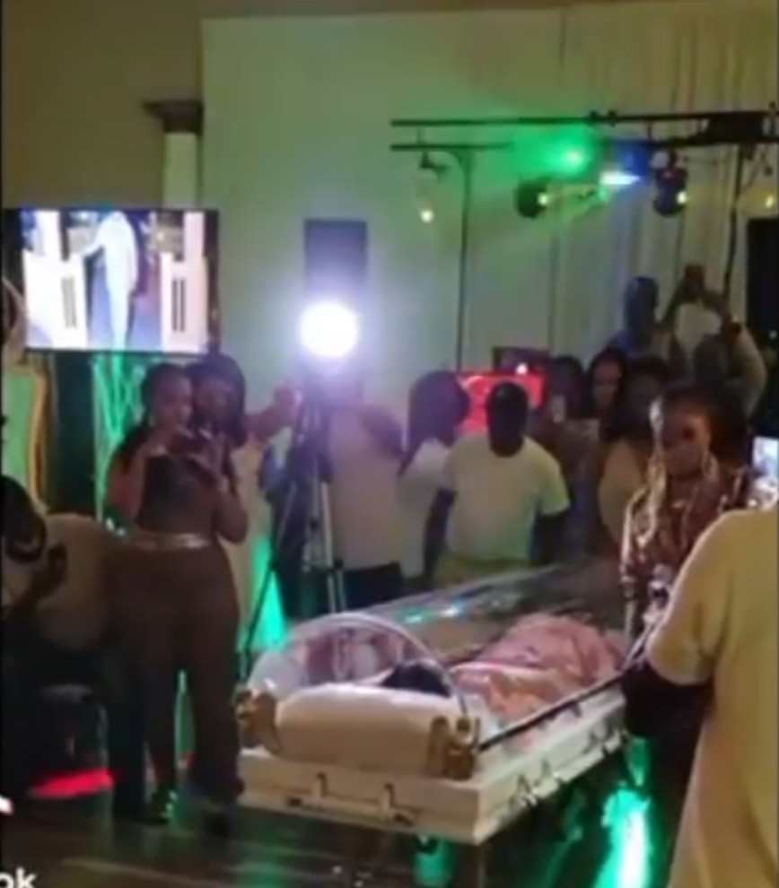 Woman attends her own birthday party inside coffin