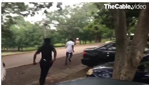 Police officer chasing IPOB supporter