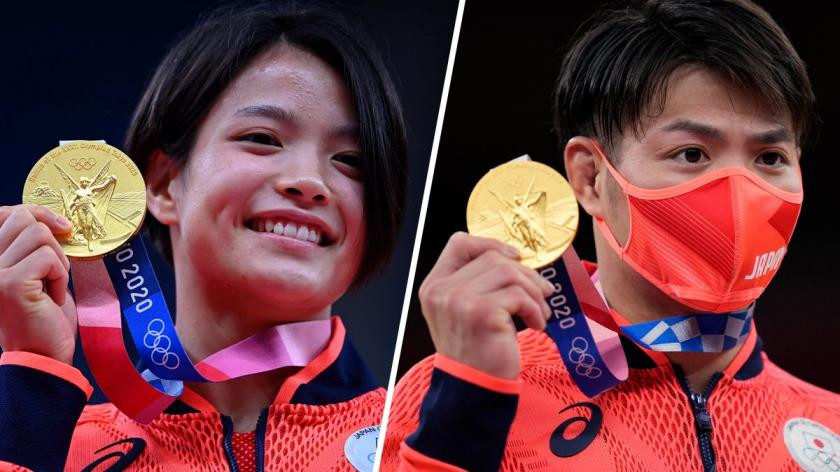 The siblings made history winning gold on the same day