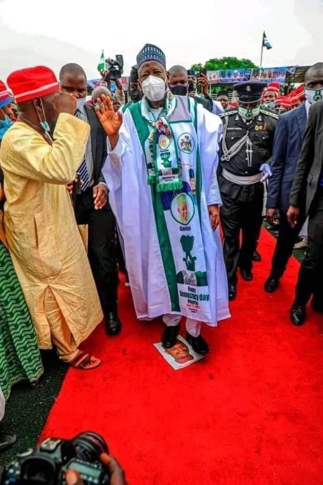Ganduje steps on Rabiu Musa Kwankwaso's picture during rally