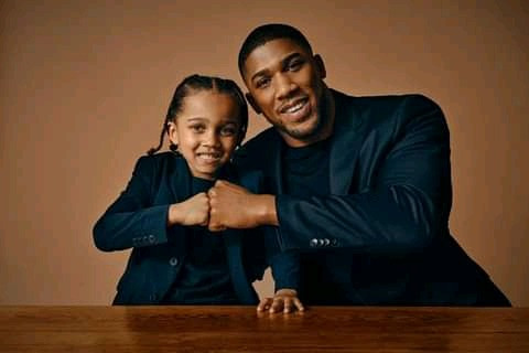 Joshua posing with son to celebrate Father's Day
