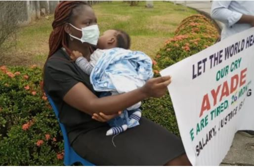 Female magistrate protesting with her baby after months of unpaid salaries
