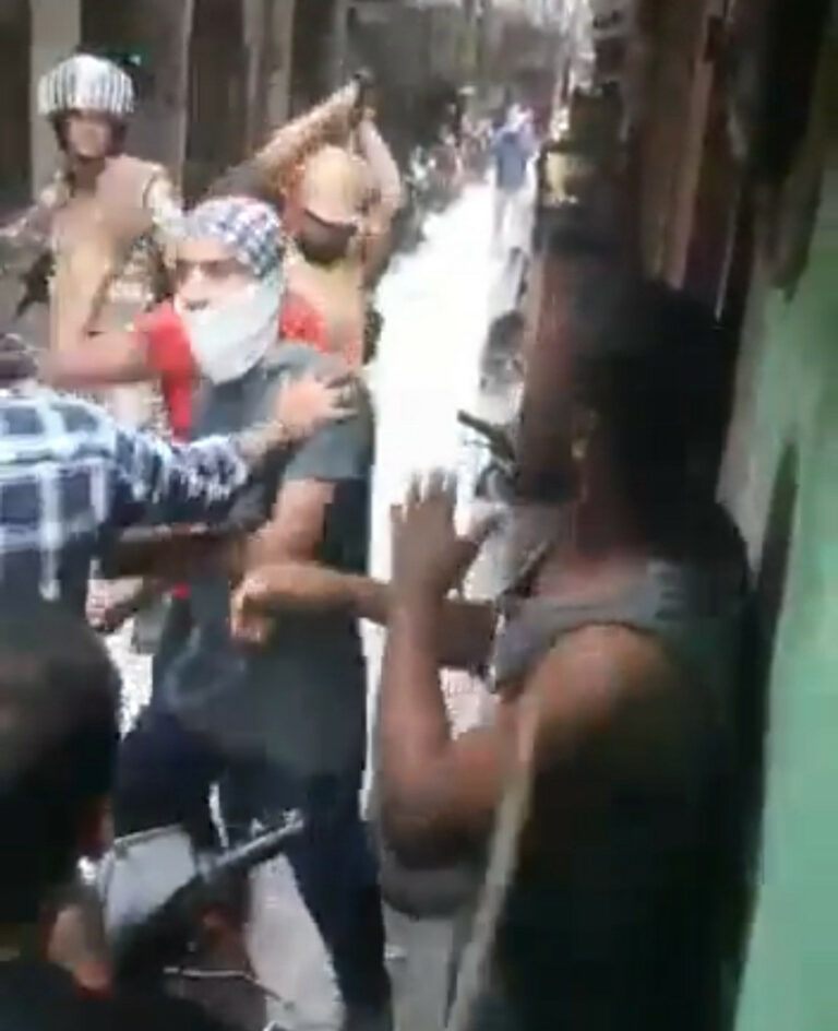 Soldiers and civilians beat Nigerians with iron rod