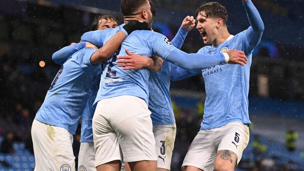 Machester City players jubilate