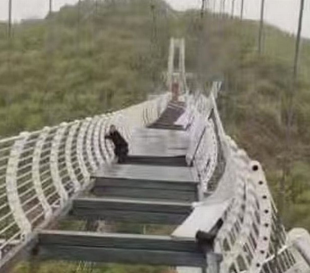 Glass bridge shatters while man was walking on it