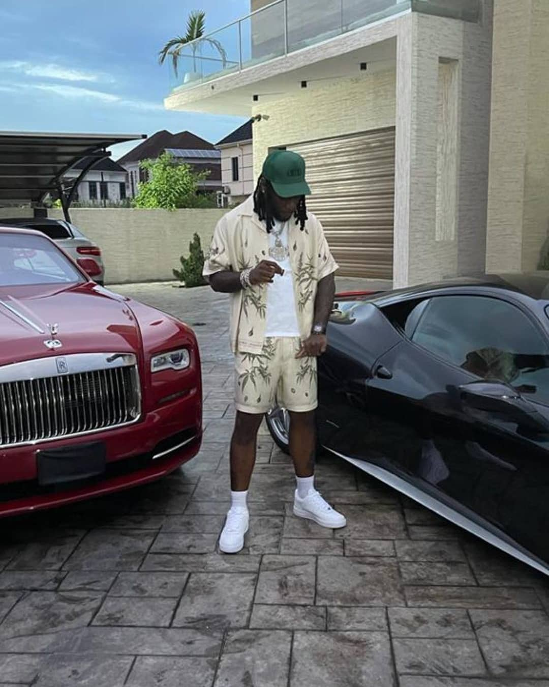 Burna Boy shows off his expensive garage