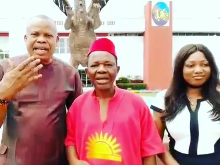 A photo of actors posing with Agu following his alleged release on Friday