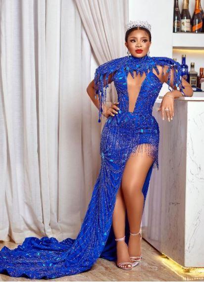 Queen flawless in blue dress