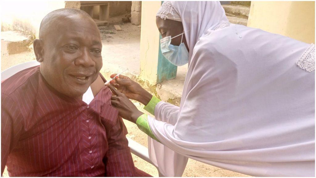 Abraham taking the vaccine