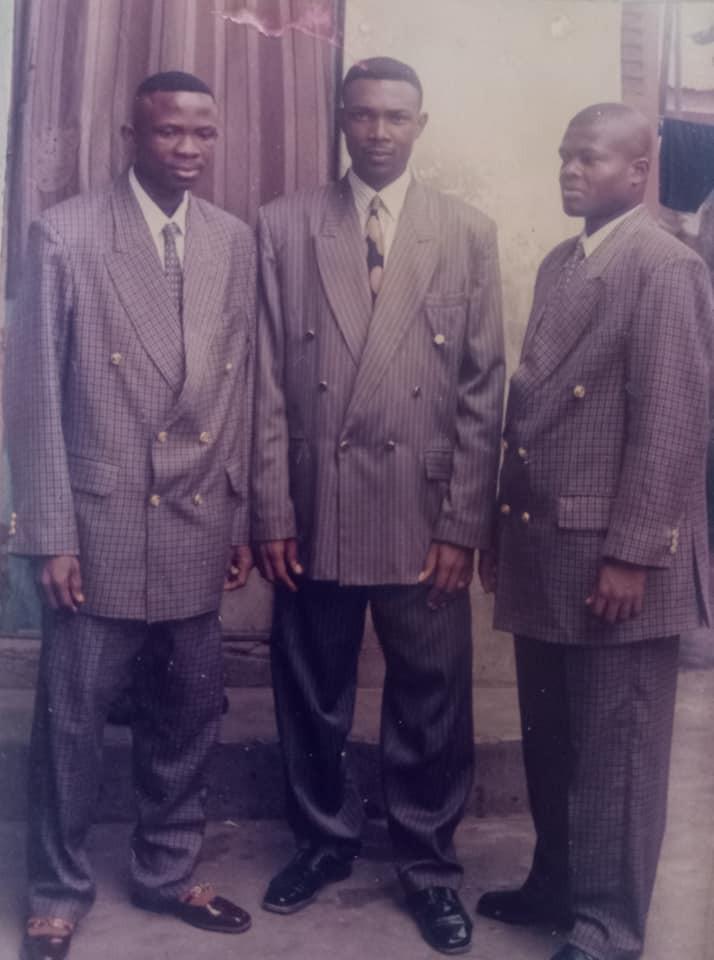 Ogbu and friends wearing coat