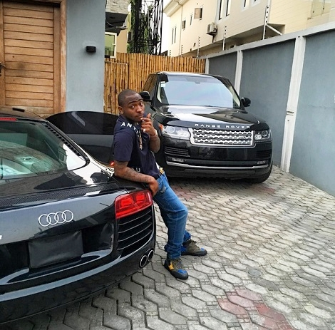 Davido Posing With Some Of His Cars