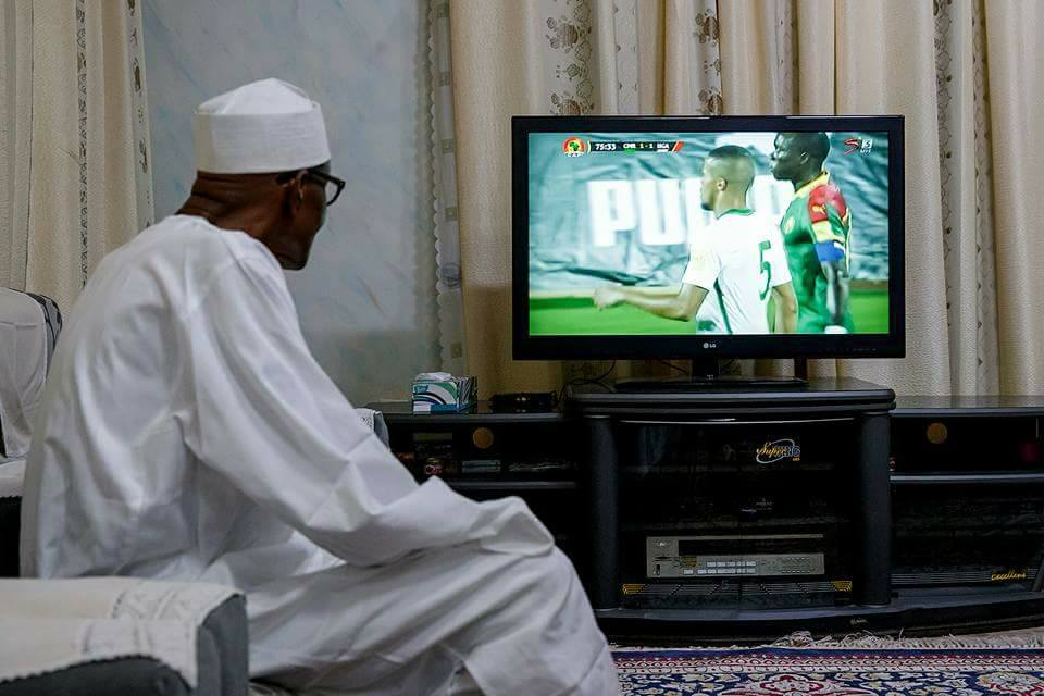 Image result for buhari watching nigeria match